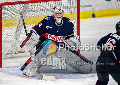 9 February 2020: University of Connecticut Husky Goaltender Morgan Fisher, a Senior from Vernon, CT, keeps her eye on a floating puck in third period action against the University of Vermont Catamounts at Gutterson Fieldhouse in Burlington, Vermont. The Lady Cats defeated the Huskies 6-2 in the second game of their weekend Hockey East series. Mandatory Credit: Ed Wolfstein Photo *** RAW (NEF) Image File Available ***