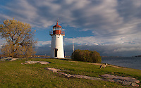 Greeting the morning sun after the passing storm at Crossover Island Lighthouse in 1000 Islands of the St. Lawrence River.