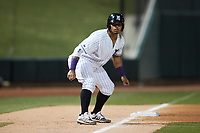 Harvin Mendoza (17) of the Winston-Salem Dash takes his lead off of third base against the Bowling Green Hot Rods at Truist Stadium on September 9, 2021 in Winston-Salem, North Carolina. (Brian Westerholt/Four Seam Images)