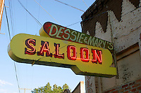 A neon sign marks the location of Dessie & Marry's Saloon in Austin, Nevada. Austin is on US Highway 50 & the Lincoln Highway in Central Nevada. Austin was founded in 1863 as a mining town and quickly grew to a population of 10,000 people. Today Austin has a population of 200 and many of the buildings from its mining past remain.