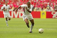 Tony Sanneh dribbles upfield. The USA tied South Korea, 1-1, during the FIFA World Cup 2002 in Daegu, Korea.