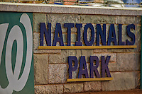 26 July 2013: A Washington Nationals sign is seen on the stone backstop of the ballpark during a game between the Washington Nationals and the New York Mets at Nationals Park in Washington, DC. The Nationals bounced back from their loss in the first game of their day/night doubleheader, with a 2-1 nightcap win. Mandatory Credit: Ed Wolfstein Photo *** RAW (NEF) Image File Available ***