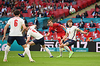 7th July 2021, Wembley Stadium, London, England; 2020 European Football Championships (delayed) semi-final, England versus Denmark;  Goal chance for Denmark as Harry MAGUIRE and Declan RICE ENG try to stop the shot from Mikkel DAMSGAARD DEN