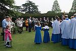 Palm Sunday Cross open air service. St Mary the Virgin, Church of England, Merton, South Wimbledon, London UK.