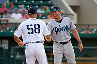 Tampa Tarpons manager Pat Osborn (13) shakes hands with Lakeland Flying Tigers manager Mike Rabelo (58) during introductions before a game on April 5, 2018 at Publix Field at Joker Marchant Stadium in Lakeland, Florida.  Tampa defeated Lakeland 4-2.  (Mike Janes/Four Seam Images)