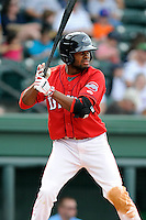 Center fielder Manuel Margot (2) of the Greenville Drive bats in a game against the Lexington Legends on Sunday, April 27, 2014, at Fluor Field at the West End in Greenville, South Carolina. Margot is the No. 13 prospect of the Boston Red Sox, according to Baseball America. Greenville won, 21-6. (Tom Priddy/Four Seam Images)