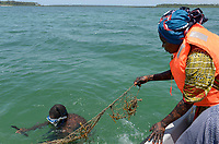 TANZANIA, Zanzibar, due to climate change and rising water temperatures seaweed farmer have shifted to plant red algae farming in deep water, women with lifejacket going by boat to plant seaweed seedlings in deep water, woman Jina Makame