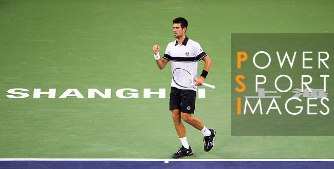 SHANGHAI, CHINA - OCTOBER 14:  Novak Djokovic of Serbia celebrates a point to Richard Gasquet of France during day four of the 2010 Shanghai Rolex Masters at the Shanghai Qi Zhong Tennis Center on October 14, 2010 in Shanghai, China.  (Photo by Victor Fraile/The Power of Sport Images) *** Local Caption *** Novak Djokovic