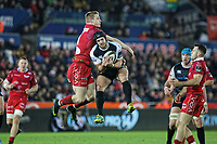 (L-R) Johnny McNicholl of the Scarlets clashes mid-air against Dan Evans of the Ospreys during the Guinness Pro14 Round 11 match between the Ospreys and the Scarlets at the Liberty Stadium, Swansea, Wales, UK. Saturday 22 December 2018