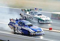 Apr. 29, 2011; Baytown, TX, USA: NHRA funny car drivers Robert Hight (near) and Mike Neff during qualifying for the Spring Nationals at Royal Purple Raceway. Mandatory Credit: Mark J. Rebilas-