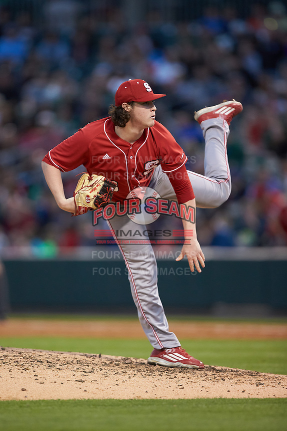 North Carolina State Wolfpack relief pitcher Ryan Williamson (28) follows through on his delivery against the Charlotte 49ers at BB&T Ballpark on March 29, 2016 in Charlotte, North Carolina. The Wolfpack defeated the 49ers 7-1.  (Brian Westerholt/Four Seam Images)