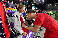 ORLANDO, FL - NOVEMBER 15: Paul Arriola #7 of the United States signs autographs for a USA fan during a game between Canada and USMNT at Exploria Stadium on November 15, 2019 in Orlando, Florida.
