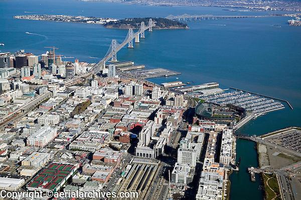 aerial AT&T baseball park and CalTrain station in San Francisco with Bay Bridge and South Beach Marina