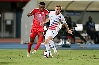 GEORGETOWN, GRAND CAYMAN, CAYMAN ISLANDS - NOVEMBER 19: Jackson Yueill #14 of the United States moves with the ball past Maykel Reyes #9 of Cuba during a game between Cuba and USMNT at Truman Bodden Sports Complex on November 19, 2019 in Georgetown, Grand Cayman.