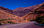 Highway from Joseph to hamlet of Imnaha, Oregon cuts along Wallowa river on its way to Hells Canyon.  Hells Canyon Scenic Byway.