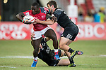 Trael Joass of New Zealand (bottom) tries to tackle Bush Mwale of Kenya who runs with the ball during the match New Zealand vs Kenya, Day 2 of the HSBC Singapore Rugby Sevens as part of the World Rugby HSBC World Rugby Sevens Series 2016-17 at the National Stadium on 16 April 2017 in Singapore. Photo by Victor Fraile / Power Sport Images