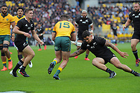 NZ's Codie Taylor tackles Australia's Tom Banks during the Bledisloe Cup rugby union match between the New Zealand All Blacks and Australia Wallabies at Sky Stadium in Wellington, New Zealand on Sunday, 11 October 2020. Photo: Dave Lintott / lintottphoto.co.nz