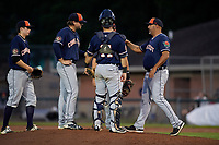 Connecticut Tigers starting pitcher Ryan Castellanos (27)  hands the ball to manager Gerald Laird (12) as catcher Andres Sthormes (14) and shortstop Will Savage (left) look on during a game against the Auburn Doubledays on August 8, 2017 at Falcon Park in Auburn, New York.  Auburn defeated Connecticut 7-4.  (Mike Janes/Four Seam Images)