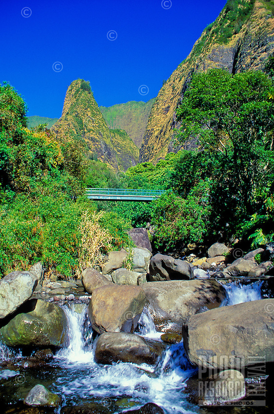 Georgeous view of the small waterfall and stream in lush Iao Valley on Maui.