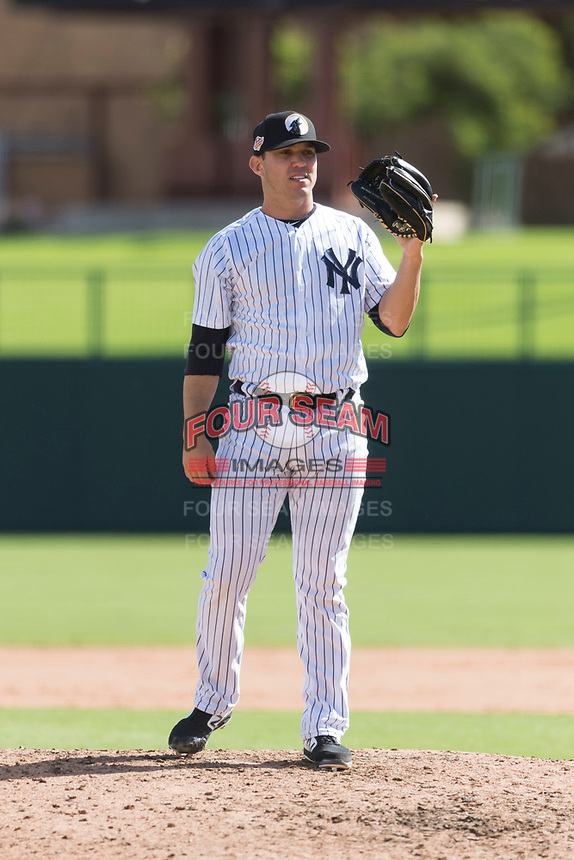 Glendale Desert Dogs relief pitcher Matt Wivinis (30), of the New York Yankees organization, waits to receive the ball back from the catcher during an Arizona Fall League game against the Scottsdale Scorpions at Camelback Ranch on October 16, 2018 in Glendale, Arizona. Scottsdale defeated Glendale 6-1. (Zachary Lucy/Four Seam Images)