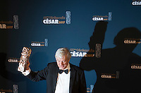 """Director Paul Verhoeven poses during a photocall after receiving the Best Film Award for his film """"Elle"""" at the 42nd Cesar Awards ceremony in Paris, France, February 24, 2017."""