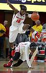 Rutgers women's basketball takes on Northeastern at the Louis Brown Athletic Center in Piscataway.<br /> <br /> Rutgers # 15 (top) Syessense Davis leaps over fallen team mate # 2 Kahleah Copper. <br /> <br /> <br /> On Tuesday November 18,2014<br /> Photo: Mark R. Sullivan/Staff Photographer