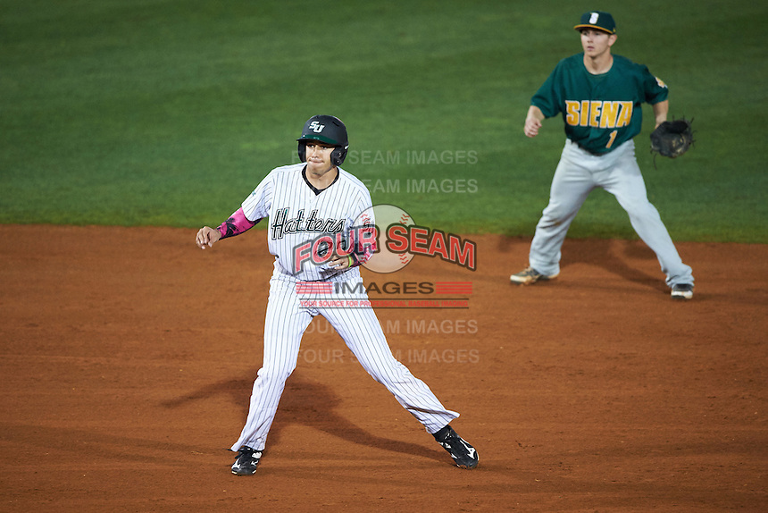 Stetson Hatters center fielder Vance Vizcaino (29) leads off second in front of shortstop Tyler Martis (1) during a game against the Siena Saints on February 23, 2016 at Melching Field at Conrad Park in DeLand, Florida.  Stetson defeated Siena 5-3.  (Mike Janes/Four Seam Images)