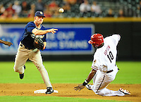 Aug. 30, 2010; Phoenix, AZ, USA; San Diego Padres second baseman David Eckstein (left) throws to first base after forcing out Arizona Diamondbacks baserunner Justin Upton at Chase Field. Mandatory Credit: Mark J. Rebilas-