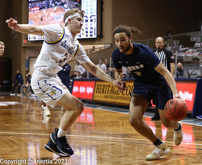 SIOUX FALLS, SD - MARCH 8: Kareem Thompson #2 of the Oral Roberts Golden Eagles drives on Baylor Scheierman #3 of the South Dakota State Jackrabbitsduring the Summit League Basketball Tournament at the Sanford Pentagon in Sioux Falls, SD. (Photo by Richard Carlson/Inertia)