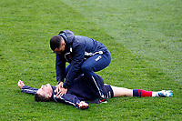 Josh Barton of London Scottish receives treatment from Owen Nicholls during the Greene King IPA Championship match between London Scottish Football Club and Ampthill RUFC at Richmond Athletic Ground, Richmond, United Kingdom on 26 October 2019. Photo by Carlton Myrie.