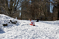 NEW YORK, NEW YORK - FEBRUARY 21: A girl slide in Central Park covered by snow and ice  on February 21, 2021 in New York City. The big apple waits this monday the last snowfall before a midweek warm up.  (Photo by John Smith/VIEWpress via Getty Images)