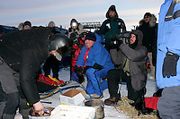 Sunday March 11, 2007   ----   Lance Mackey gives the Iditarod Insider group an interview as he cooks food for his dogs at the Unalakleet checkpoint on Sunday evening.