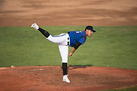 Missoula Osprey starting pitcher Edgar Martinez (15) follows through on his delivery during a Pioneer League game against the Grand Junction Rockies at Ogren Park Allegiance Field on August 21, 2018 in Missoula, Montana. The Missoula Osprey defeated the Grand Junction Rockies by a score of 2-1. (Zachary Lucy/Four Seam Images)