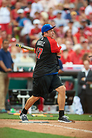 Comedian Rob Riggle bats during the All-Star Legends and Celebrity Softball Game on July 12, 2015 at Great American Ball Park in Cincinnati, Ohio.  (Mike Janes/Four Seam Images)