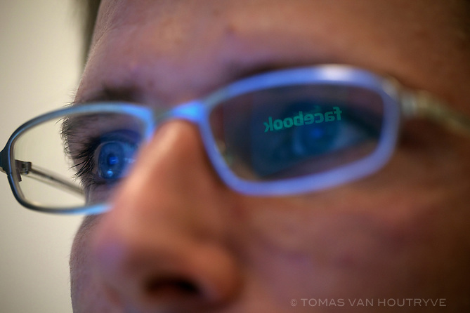 The word Facebook, written on a computer screen, is reflected in the glasses of an employee working inside the offices of Facebook in Paris, France on Nov. 29, 2010.