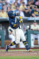 Michigan Wolverines second baseman Ako Thomas (4) swings the bat against the Vanderbilt Commodores during Game 3 of the NCAA College World Series Finals on June 26, 2019 at TD Ameritrade Park in Omaha, Nebraska. Vanderbilt defeated Michigan 8-2 to win the National Championship. (Andrew Woolley/Four Seam Images)