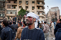 An anti-government protester injured in violent clashes with pro-Mubarak supporters in Tahrir Square. Continued anti-government protests take place in Cairo calling for President Mubarak to stand down. After dissolving the government, Mubarak still refuses to step down from power.