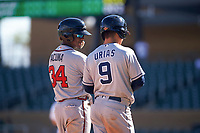 Peoria Javelinas center fielder Ronald Acuna (34), of the Atlanta Braves organization, and Luis Urias (9), of the San Diego Padres organization, talk during a pitching change at an Arizona Fall League game against the Salt River Rafters on October 16, 2017 at Salt River Fields at Talking Stick in Scottsdale, Arizona.  Peoria defeated Salt River 6-2.  (Zachary Lucy/Four Seam Images)