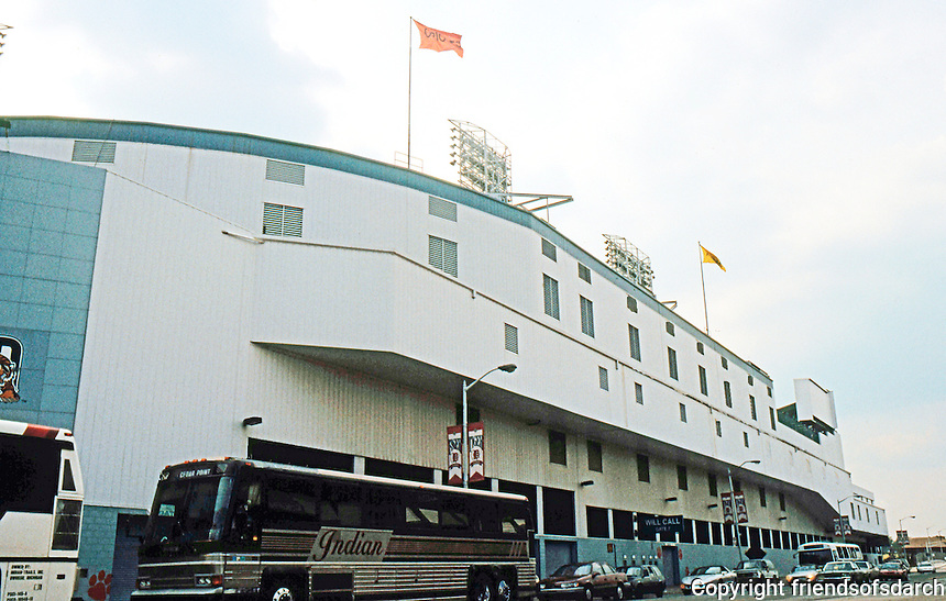 Ballparks: Detroit--Tiger Stadium. Trumbull Ave. Facade--stands cantilevered over street.