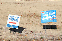 COLLEGE PARK, GA - JANUARY 5: Vote signs on I285 around the area leading to downtown Atlanta during the Georgia Senate runoff races on January 5, 2021 in College Park, Georgia. <br /> CAP/MP34<br /> ©MPI34/Capital Pictures