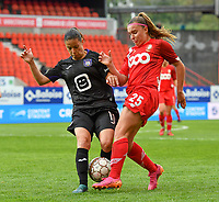 Stefania Vatafu (10) of Anderlecht pictured defending on Davinia Vanmechelen (25) of Standard  during a female soccer game between Standard Femina de Liege and RSC Anderlecht on the 8th matchday in play off 1 of the 2020 - 2021 season of Belgian Scooore Womens Super League , tuesday 18 th of May 2021  in Angleur , Belgium . PHOTO SPORTPIX.BE | SPP | DAVID CATRY