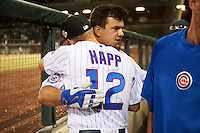 Mesa Solar Sox designated hitter Kyle Schwarber (66), of the Chicago Cubs, hugs Ian Happ (12) after the Cubs clinched a trip to the World Series during a game against the Salt River Rafters on October 22, 2016 at Sloan Park in Mesa, Arizona.  It was the first game action for Schwarber who was injured April 7th and underwent surgery to repair two ligament tears in his left knee.  Salt River defeated Mesa 7-2.  (Mike Janes/Four Seam Images)