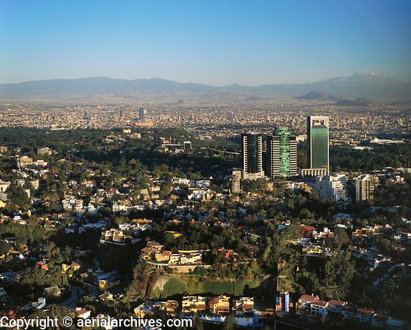 aerial photograph of Las Lomas district Mexico City toward the Popocatepetl and Iztaccihuatl volcanoes