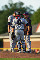 Mahoning Valley Scrappers pitcher Greg Hibbard (right) talks with pitcher pitcher Casey Shane (34) and catcher Li-Jen Chu (16) during a game against the Batavia Muckdogs on July 3, 2015 at Dwyer Stadium in Batavia, New York.  Batavia defeated Mahoning Valley 7-4.  (Mike Janes/Four Seam Images)