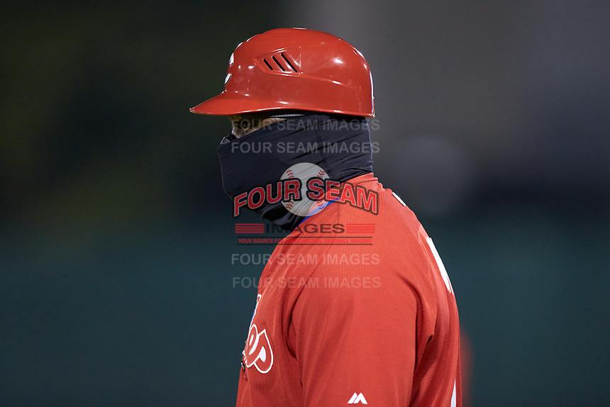 Philadelphia Phillies scout Tim Moni coaches first base during the East Coast Pro Showcase at the Hoover Met Complex on August 2, 2020 in Hoover, AL. (Brian Westerholt/Four Seam Images)