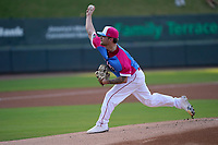 """Pitcher Chase Shugart (12) of the Greenville Drive during a game against the Brooklyn Cyclones on Saturday, May 15, 2021, at Fluor Field at the West End in Greenville, South Carolina. Drive players were wearing jerseys for the """"Ranas de Rio de Greenville"""" (Greenville River Frogs), as part of Minor League Baseball's """"Copa de la Diversion."""" (Tom Priddy/Four Seam Images)"""