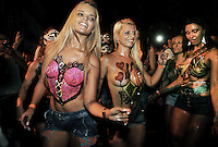 Topless dancers perform during a street parade of  Banda da Rua do Mercado, Rio de Janeiro, Brazil, February 27, 2014. People gathered Thursday for one of many parades before the official start of Carnival on Feb. 28. (Austral Foto/Renzo Gostoli)