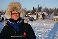 "Tuesday March 6, 2007   The official ""Teacher on the Trail"", Kim Slade from Florida watches the action at the Nikolai checkpoint on Tuesday.  The teacher on the trail, sponsored by Wells Fargo Bank Alaska, meets with students along the trail and sends back information from the trail to schools nationwide who use the Iditarod in their curriculum."