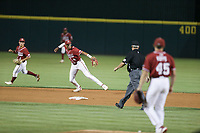 Arkansas infielder Jalen Battles (4) throws to first, Saturday, June 5, 2021 in the second game of the NCAA Fayetteville Regional at Baum-Walker Stadium in Fayetteville. Check out nwaonline.com/210606Daily/ for today's photo gallery. <br /> (NWA Democrat-Gazette/Charlie Kaijo)
