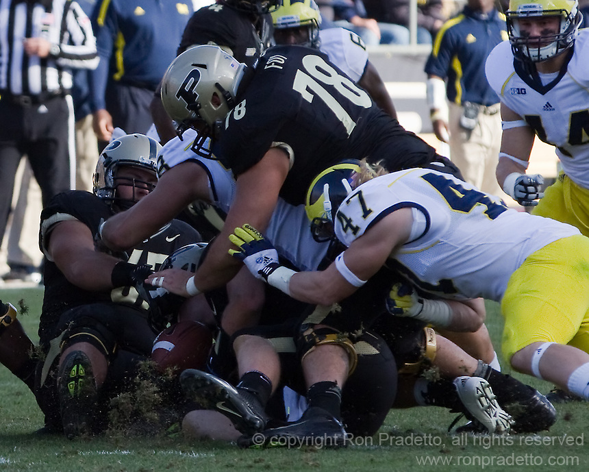 Purdue offensive Trevor Foy (78) and Michigan linebacker Jake Ryan (47) search for a loose football. The Michigan Wolverines defeated the Purdue Boilermakers 44-13 on October 6, 2012 at Ross-Ade Stadium in West Lafayette, Indiana.